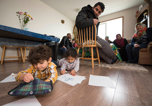 DAVID LIPNOWSKI / WINNIPEG FREE PRESS   DAVID LIPNOWSKI / WINNIPEG FREE PRESS   (Left to right) Mohammad Nour and Rimus Alhassan play as their parents take English conversation classes with Val Schellenberg whom volunteers to offer in-home families at the home of Fadel and Rania Ahmad January 17, 2017. The refugees from Syria arrived in Canada last February.