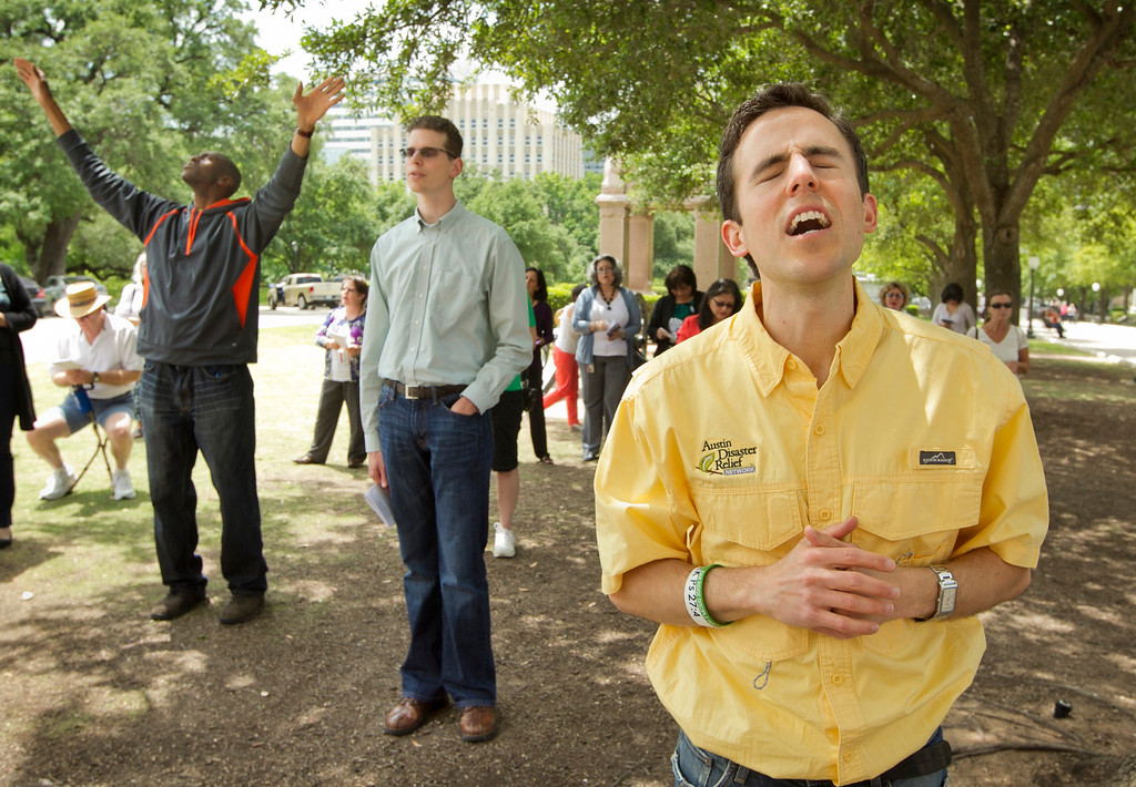 . Stephen Brewer, right, prays during the One Voice United in Prayer event at the Capitol in Austin, Texas, on Thursday May 1, 2014.  About 100 people gathered at the Capitol on the 63rd Annual National Day of Prayer to sing praise songs and pray for the church, families, the military, education, the government, business and the media.    (AP Photo/Austin American-Statesman, Jay Janner)