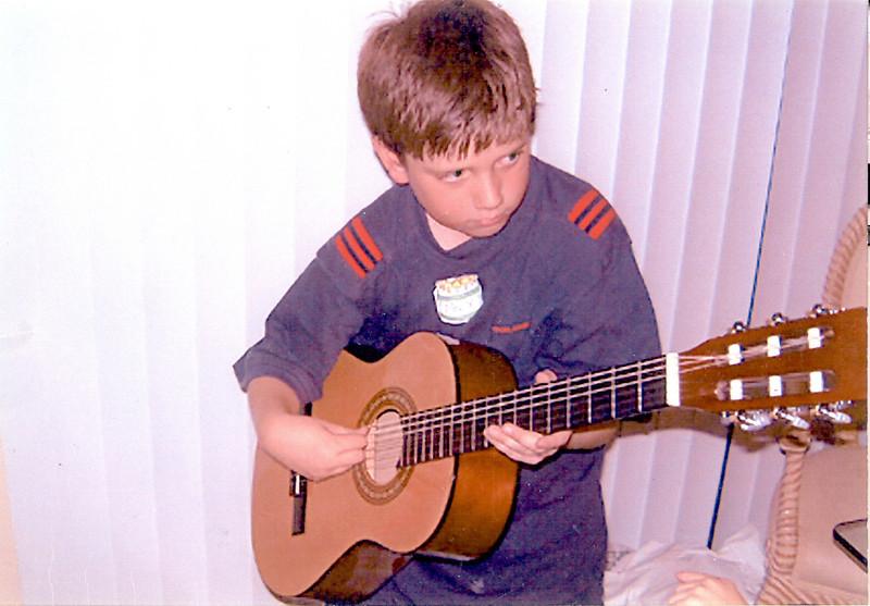 Max Playing Guitar Circa 1999.jpg