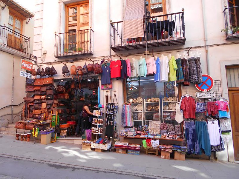 Colorful clothing, leather goods and trinkets at a Moroccan souvenir shop in Granda's Albaicin District.