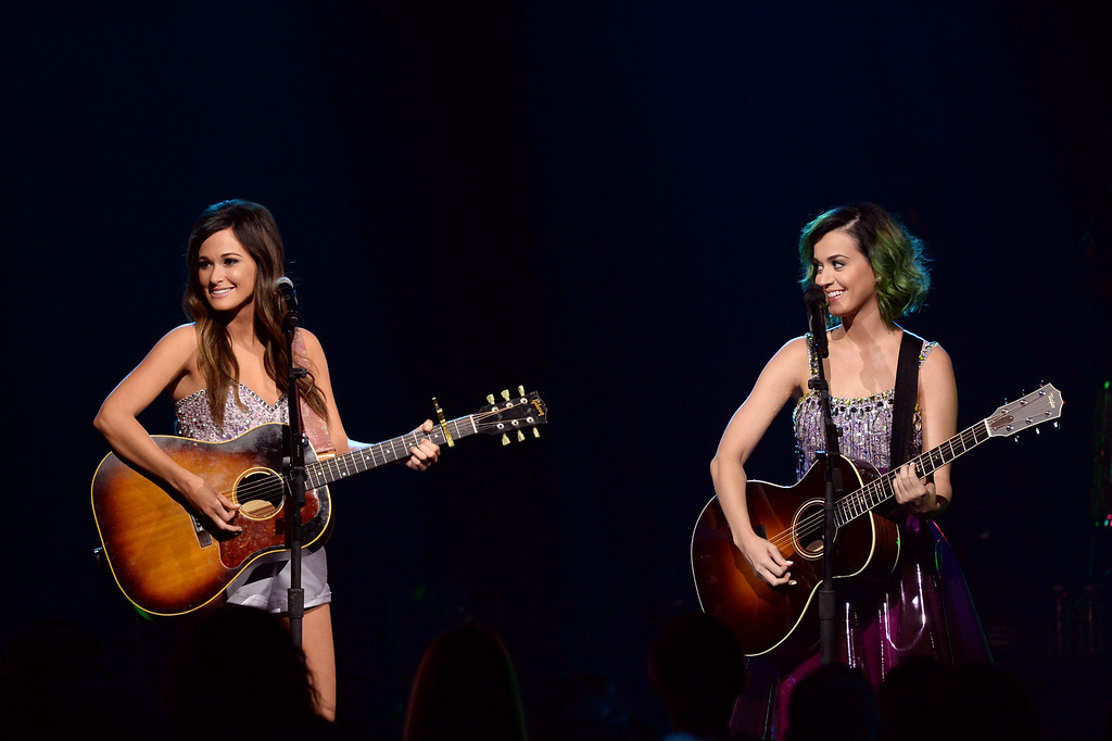 . Singers Kacey Musgraves (L) and Katy Perry perform onstage during CMT Crossroads: Katy Perry And Kacey Musgraves at Sony Pictures Studios on April 18, 2014 in Culver City, California. CMT Crossroads: Katy Perry and Kacey Musgraves premireres on CMT June 13th, 2014 at 10pm ET/PT.  (Photo by Rick Diamond/Getty Images for CMT)