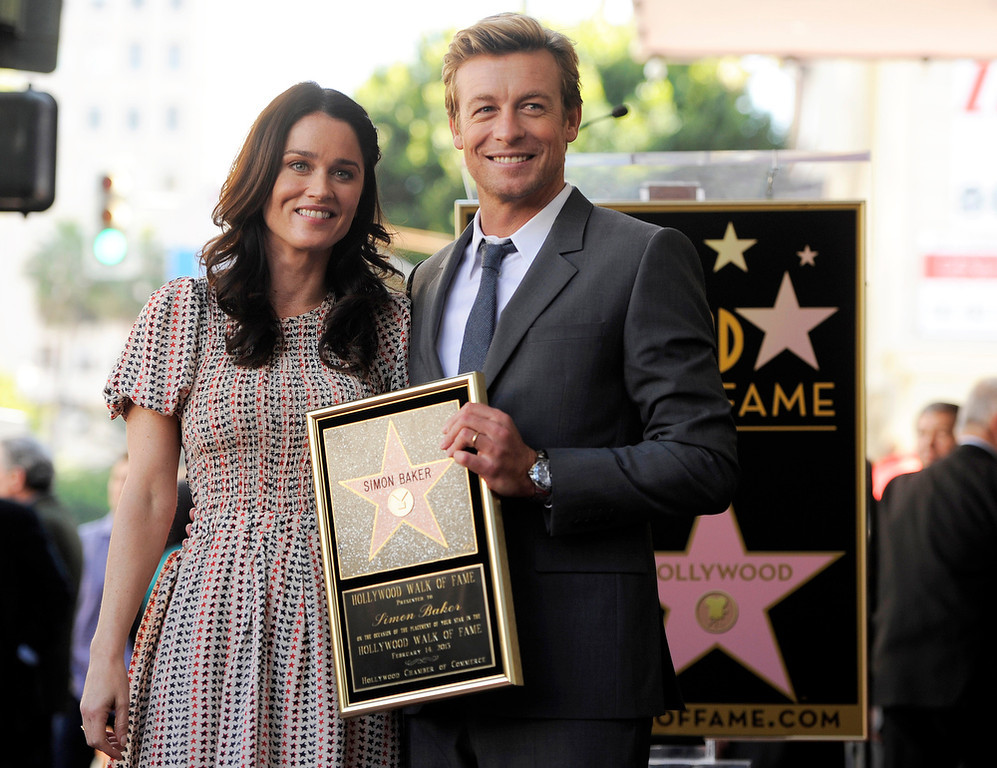""". Simon Baker, a cast member in the television series \""""The Mentalist,\"""" poses with fellow cast member Robin Tunney at a ceremony to award him a star on the Hollywood Walk of Fame, on Thursday, Feb. 14, 2013 in Los Angeles. (Photo by Chris Pizzello/Invision/AP)"""