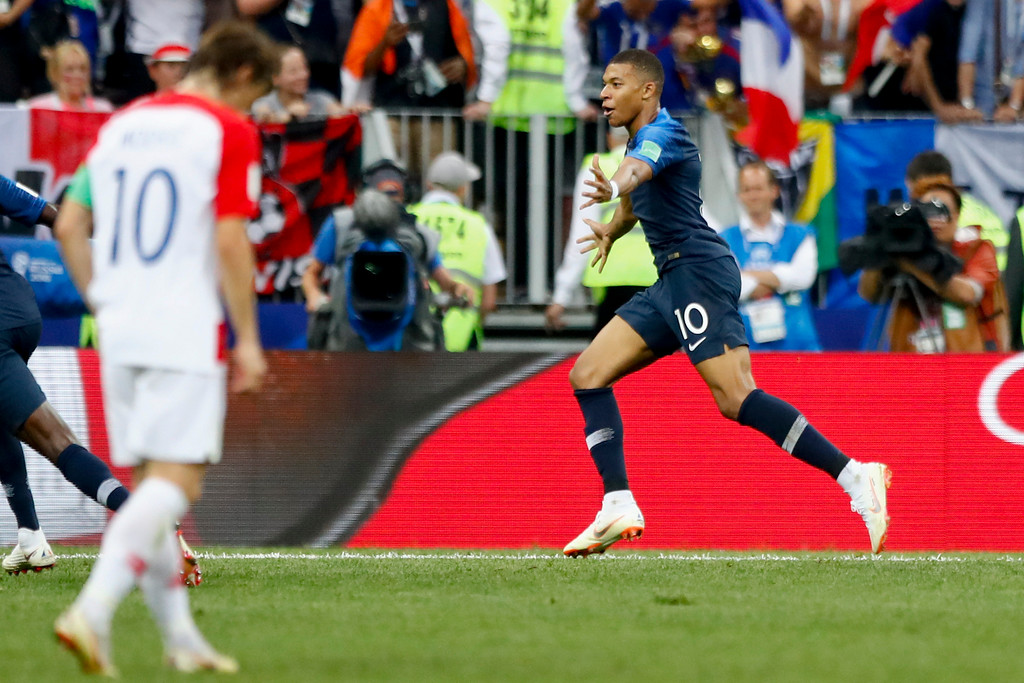 . France\'s Kylian Mbappe celebrates after scoring his side\'s fourth goal during the final match between France and Croatia at the 2018 soccer World Cup in the Luzhniki Stadium in Moscow, Russia, Sunday, July 15, 2018. (AP Photo/Matthias Schrader)