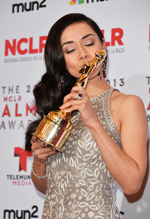 . PASADENA, CA - SEPTEMBER 27:  Actress Aimee Garcia poses with the Year in Television Award for \'Dexter\' at the Winner\'s Walk during the 2013 NCLR ALMA Awards at Pasadena Civic Auditorium on September 27, 2013 in Pasadena, California.  (Photo by Alberto E. Rodriguez/Getty Images for NCLR)
