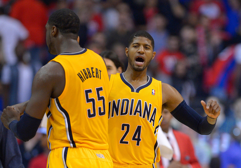 . Indiana Pacers center Roy Hibbert, left, and Paul George celebrate in the closing seconds of the second half of an NBA basketball game against the Los Angeles Clippers, Sunday, Dec. 1, 2013, in Los Angeles. (AP Photo/Mark J. Terrill)