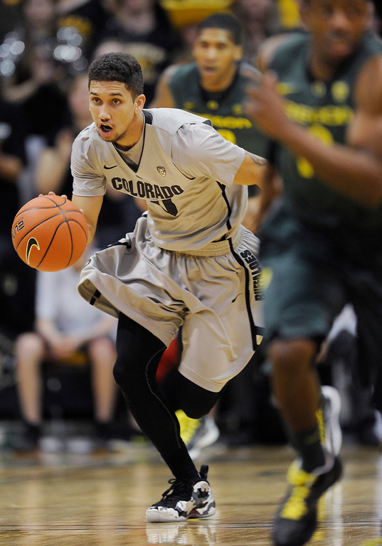 . BOULDER, CO. - MARCH 7: Colorado guard Askia Booker (0) pushed the tempo in the second half. The University of Colorado men\'s basketball team defeated Oregon 76-53 Thursday night, March 7, 2013 at the CU Events Center in Boulder. (Photo By Karl Gehring/The Denver Post)