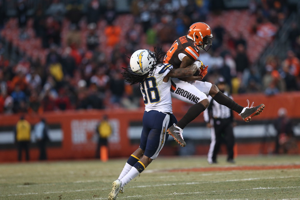 . Cleveland Browns wide receiver Corey Coleman (19) makes a catch for a first down against San Diego Chargers cornerback Trovon Reed (38) in the second half of an NFL football game, Saturday, Dec. 24, 2016, in Cleveland. The Browns won 20-17. (AP Photo/Aaron Josefczyk)