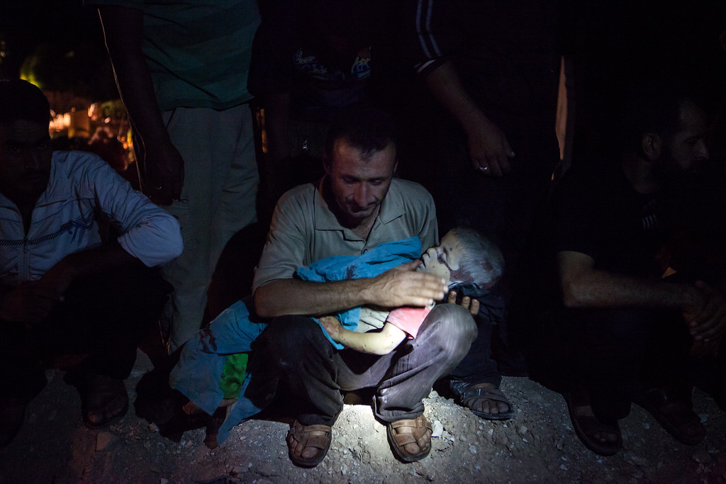 . The father of three-year-old Khaled Baour weeps as he holds the body of his son who was killed alongside his older sister Safia, 14, after a shell landed on their family home while they gathered to break their fast with the iftar meal, prior to their burial  late on July 13, 2013 in Maaret Al-Numan in Syria\'s southern Idlib province. The conflict in Syria began in 2011, with peaceful demonstrations calling for regime change but morphed into an insurgency after the regime unleashed a crackdown on dissent. DANIEL LEAL-OLIVAS/AFP/Getty Images