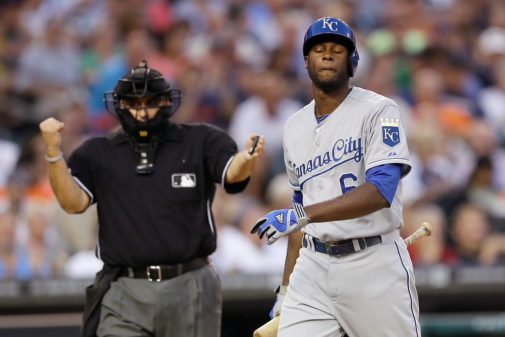 . Kansas City Royals\' Lorenzo Cain walks back to the dugout as home plate umpire Eric Cooper calls him out during the second inning of a baseball game against the Detroit Tigers in Detroit, Tuesday, Sept. 9, 2014. (AP Photo/Carlos Osorio)