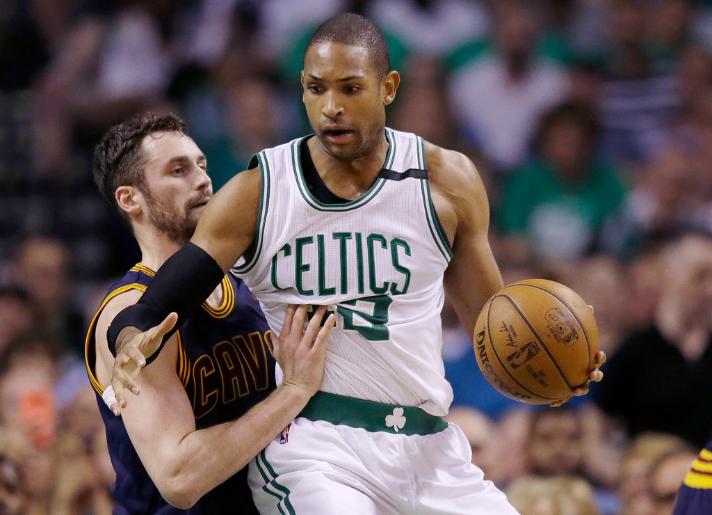 . Cleveland Cavaliers forward Kevin Love, left, defends Boston Celtics center Al Horford during the first quarter of Game 1 of the NBA basketball Eastern Conference finals, Wednesday, May 17, 2017, in Boston. (AP Photo/Charles Krupa)