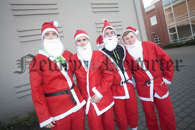 Aaron Hughes, Paul O'Hanlon, Ryan Crozier and Luke Owens who took part in St Paul's Annual Santa Run. R1551018