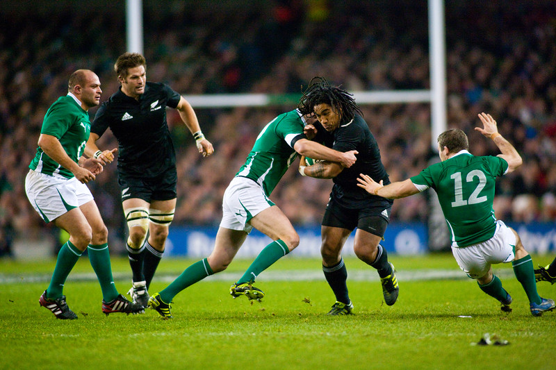 Ma'a Nonu takes the tackle whilst Richie McCaw and Rory Best look on. During the International rugby test with Ireland against the New Zealand All Blacks at Aviva Stadium Dublin