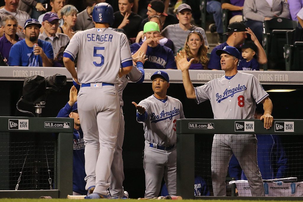 . DENVER, CO - APRIL 22:  Manager Dave Roberts #30 of the Los Angeles Dodgers and bench coach Bob Geren #8 welcome Joc Pederson #31 and Corey Seager #5 back to the dugout after they scored on a single by Adrian Gonzalez #23 off of Jon Gray #55 of the Colorado Rockies to take a 5-4 lead in the fifth inning at Coors Field on April 22, 2016 in Denver, Colorado.  (Photo by Doug Pensinger/Getty Images)