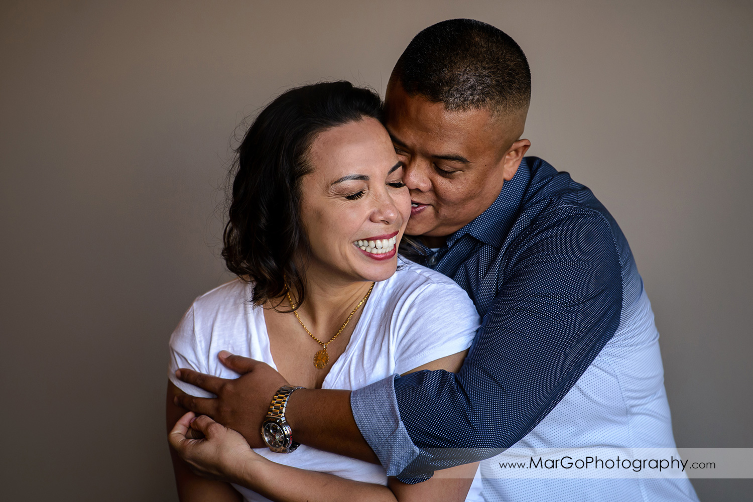 engagement session at Ferry Building in San Francisco - hugging couple