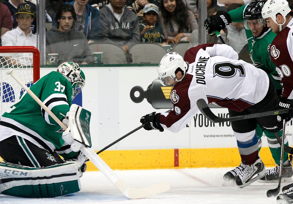 . Dallas Stars goalie Kari Lehtonen (32), of Finland, stops a shot attempt by Colorado Avalanche\'s Matt Duchene (9) as Ryan O\'Reilly (90) and Stars\' Brenden Dillon (4) watch in the first period of an NHL hockey game, Friday, Nov. 1, 2013, in Dallas. (AP Photo/Tony Gutierrez)