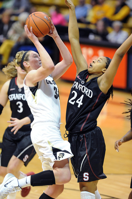 . Jen Reese of CU shoots over Erica McCall of Stanford during the second half of the January 12, 2014 game in Boulder. Cliff Grassmick/Daily Camera