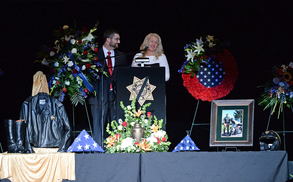 . Sgt. David Baldwin\'s son Joshua, left and David\'s wife Crystal spoke to thousand who attended the funeral of Sgt. David Baldwin at the First Bank Events Center in Broomfield, February, 03 2014. Baldwin was on motorcycle patrol riding north on Colorado 93 on Sunday morning when he was hit by a vehicle that crossed the double-yellow line. (Photo by RJ Sangosti/The Denver Post)