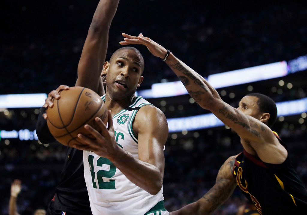 . Boston Celtics forward Al Horford (42) looks to make a move against Cleveland Cavaliers guard George Hill, right, during the third quarter of Game 5 of the NBA basketball Eastern Conference finals Wednesday, May 23, 2018, in Boston. (AP Photo/Charles Krupa)