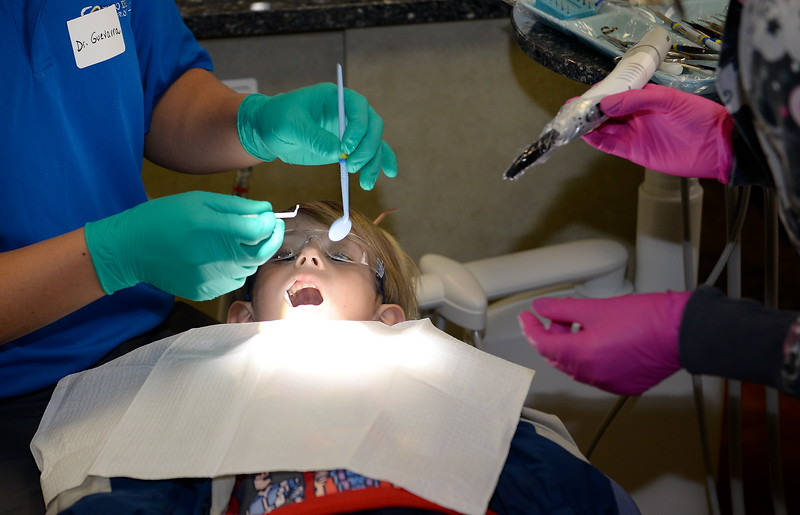 Brave 6-year-old patient Max Lafrance of Orland gets a cleaning and a filling by Dr. Philip Guevarra during the Youthful Smiles program at Chico Pediatric Dentistry Friday Feb. 3, 2017. (Bill Husa -- Enterprise-Record)