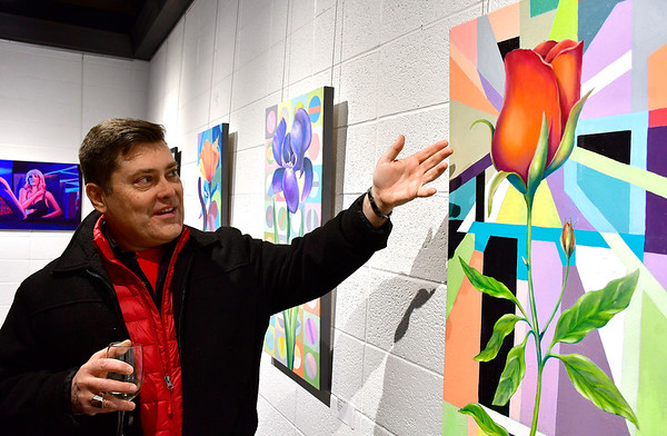 "1/10/2019 Mike Orazzi | Staff Artist Paul Gobell talks about his piece ""e;Inluminent Rose""e; during the Greater New Britain Arts Alliance Artist Members Show held at the Stockman Gallery in downtown New Britain Thursday night."