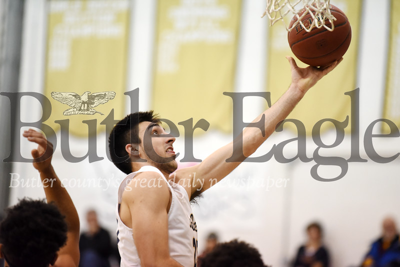 Harold Aughton/Butler Eagle: Butler's Ethan Morton takes the ball to the hoop in the first quarter against Woodland Hills, Friday, Dec. 6, 2019.