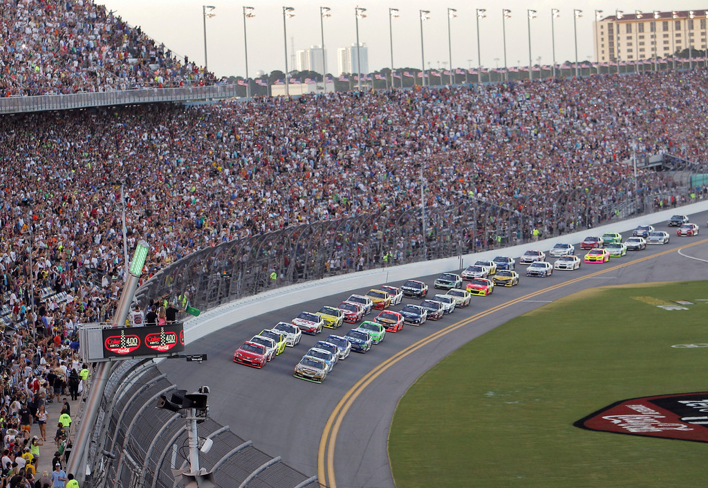 . Kyle Busch, front right, and Matt Kenseth front left, lead the the field of cars to start the NASCAR Sprint Cup auto race at Daytona International Speedway, Saturday, July 6, 2013, in Daytona Beach, Fla. (AP Photo/David Graham)