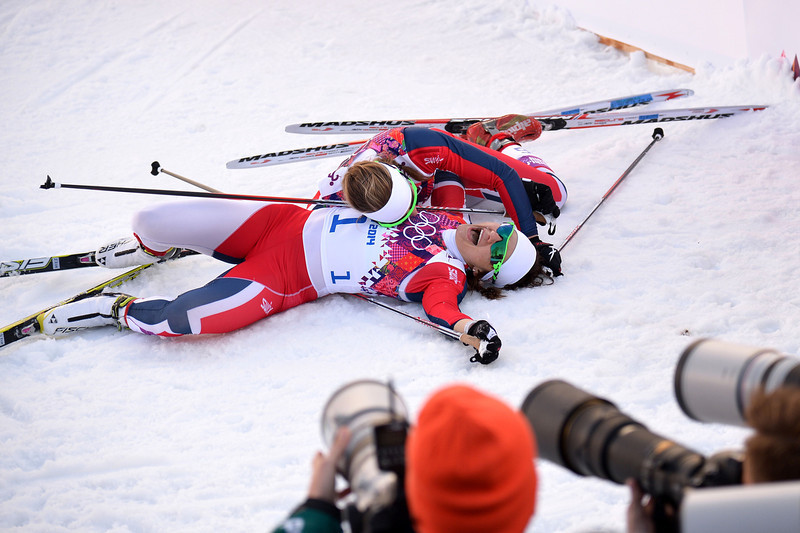 . (LtoR) Silver medalist Norway\'s Ingvild Flugstad Oestberg and gold medalist Norway\'s Maiken Caspersen Falla celebrate after the Women\'s Cross-Country Skiing Individual Sprint Free Final at the Laura Cross-Country Ski and Biathlon Center during the Sochi Winter Olympics on February 11, 2014 in Rosa Khutor near Sochi.  (ALBERTO PIZZOLI/AFP/Getty Images)