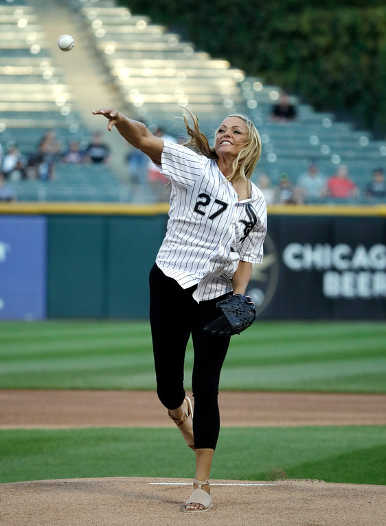 . Jennie Finch, a former Arizona college softball All-American and a U.S. Olympian, throws out the ceremonial first pitch prior to a baseball game between the Cleveland Indians and the Chicago White Sox, Friday, Aug. 10, 2018, in Chicago. (AP Photo/Nam Y. Huh)