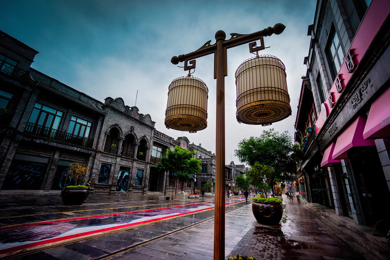 """The Daytime Lights of Front Gate Street Here's a shot from a really great street in Beijing called """"Front Gate"""" — it's certainly worth a trip. I was lucky that it rained hard all morning and I really got taking photos after it stopped. When the streets are nice and wet and I am personally not getting wet – that is one of the best times! - Trey RatcliffClick here to read the rest of this post at the Stuck in Customs blog."""