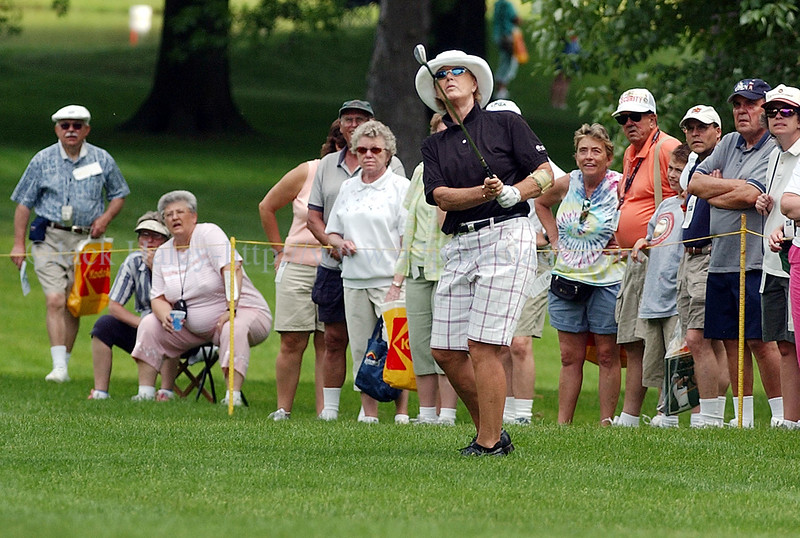 jhgolf4 - Pat Bradley and those in the gallery watch her hit out of the rough along the fourth fairway.