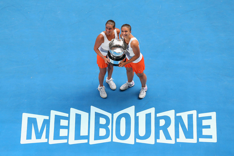 . Roberta Vinci and Sara Errani of Italy pose with the championship trophy after winning their doubles final match against Ashleigh Barty and Casey Dellacqua of Australia during day twelve of the 2013 Australian Open at Melbourne Park on January 25, 2013 in Melbourne, Australia.  (Photo by Cameron Spencer/Getty Images)