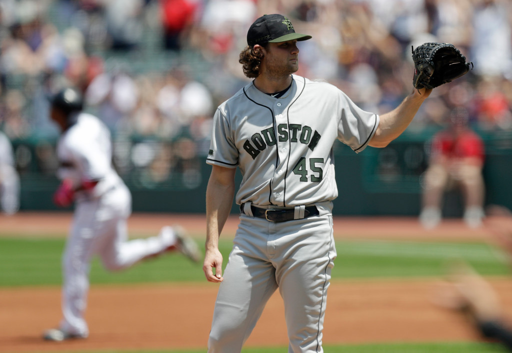 . Houston Astros starting pitcher Gerrit Cole waits for a ball as Cleveland Indians\' Jose Ramirez runs the bases after Ramirez hit a two-run home run in the first inning of a baseball game, Sunday, May 27, 2018, in Cleveland. (AP Photo/Tony Dejak)