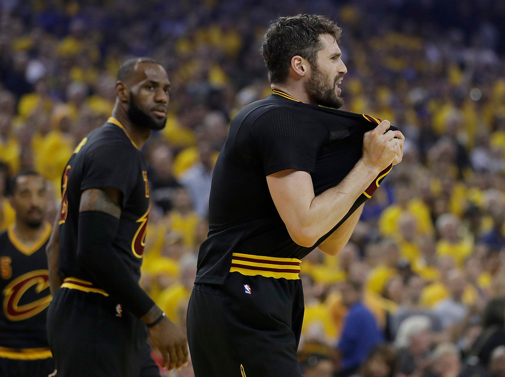 . Cleveland Cavaliers forward Kevin Love, right, reacts next to forward LeBron James during the first half of Game 5 of basketball\'s NBA Finals against the Golden State Warriors in Oakland, Calif., Monday, June 12, 2017. (AP Photo/Marcio Jose Sanchez)