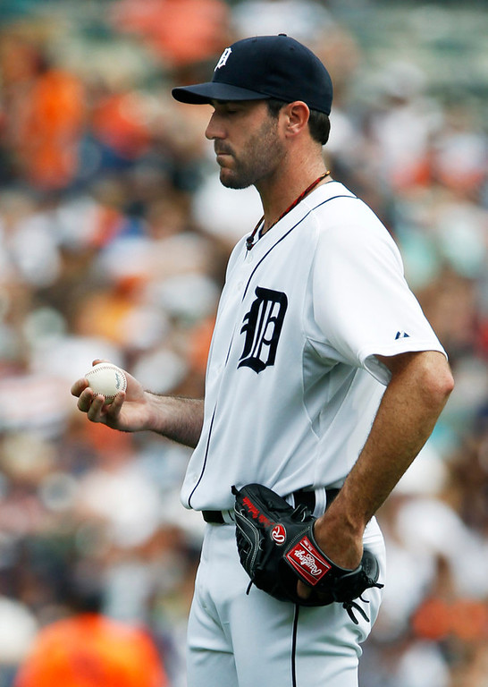 . Tigers starter Justin Verlander gathers his wits after giving up a three-run shot to Twins catcher Ryan Doumit in the fifth inning. Verlander was ripped by the Twins for six earned runs on 10 hits and three walks (one intentional) in seven innings of work.  (AP Photo/Duane Burleson)