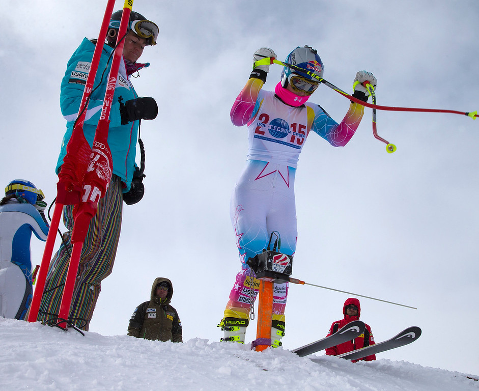 . Lindsey Vonn, of Vail, Colo., clicks her ski poles at the starting gate during the first speed training at the U.S. Ski Team training center at Copper Mountain, Colo., on Wednesday, Nov. 6, 2013. (AP Photo/Nathan Bilow)