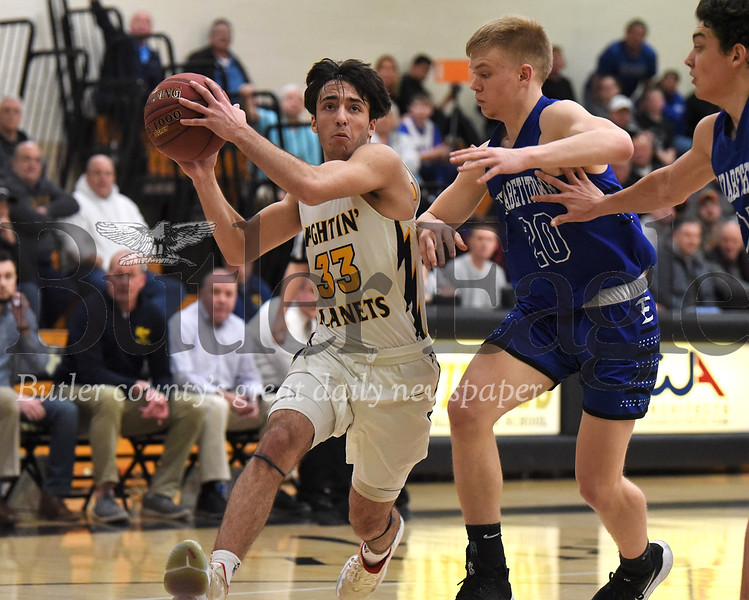 Mars' Mihali Sfanos (33) drives the lane against Elizabethtown's Luke Pierson(20). The Planets fell to Elizabethtown 68-66 in overtime. Seb Foltz/Butler Eagle