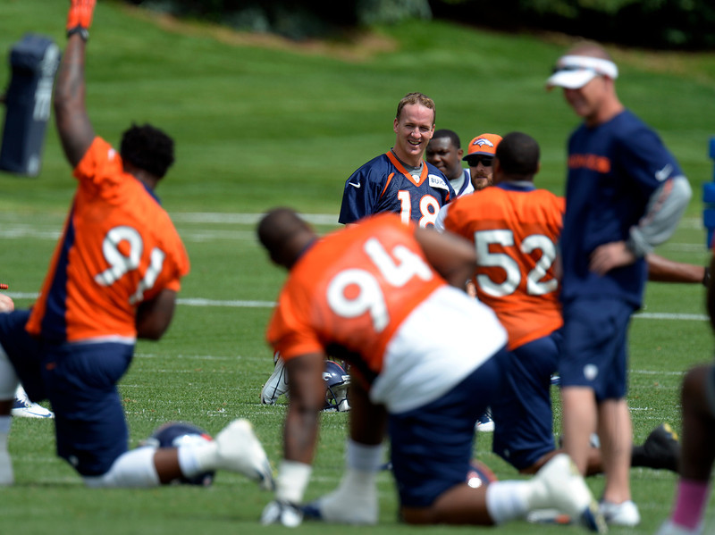 . Peyton Manning (18) of the Denver Broncos looks on while stretching during mini camp June 12, 2013 at Dove Valley. (Photo By John Leyba/The Denver Post)
