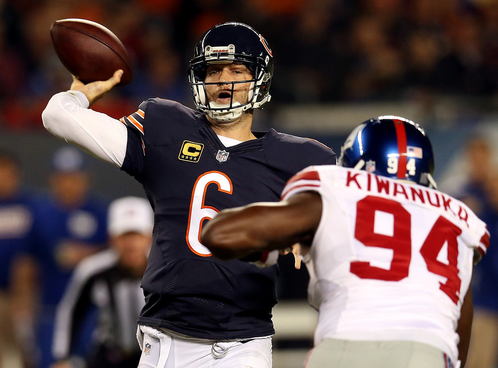 . Quarterback Jay Cutler #6 of the Chicago Bears drops back to pass as defensive end Mathias Kiwanuka #94 of the New York Giants puts pressure on during a game at Soldier Field on October 10, 2013 in Chicago, Illinois.  (Photo by Jonathan Daniel/Getty Images)