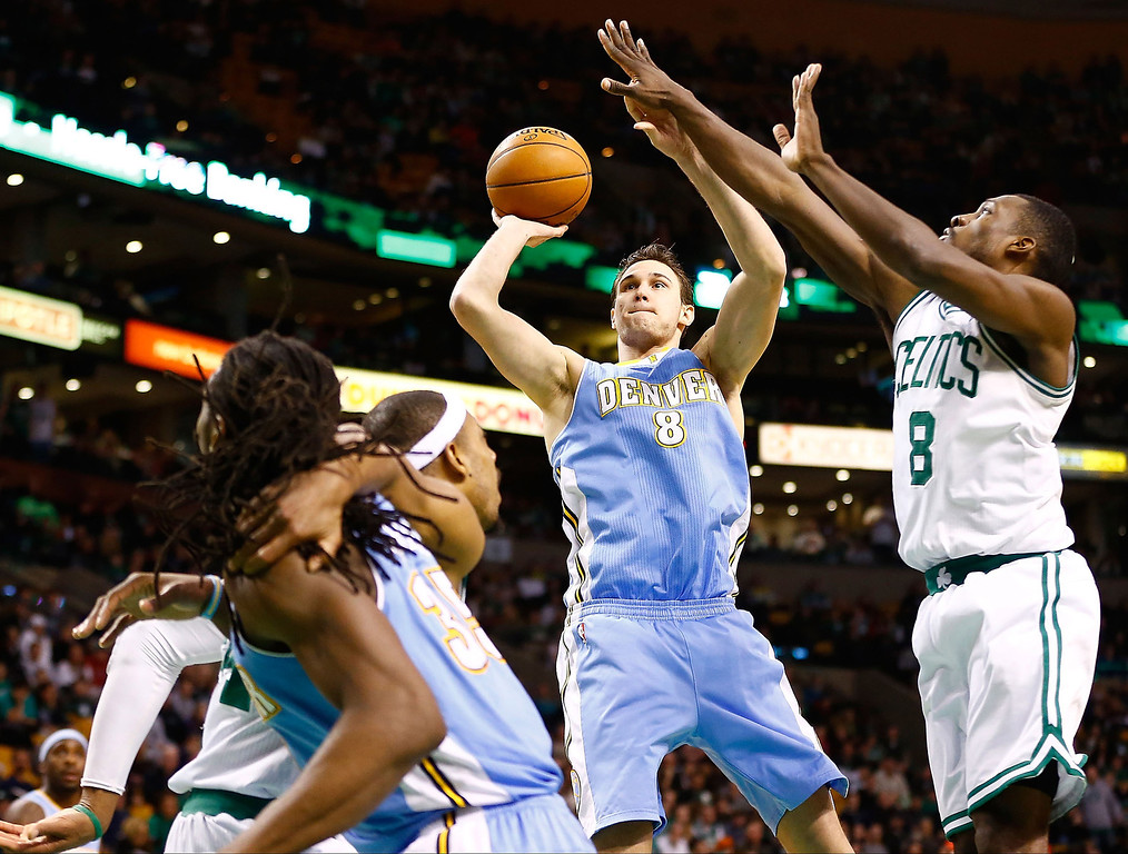 . BOSTON, MA - FEBRUARY 10: Danilo Gallinari #8 of the Denver Nuggets takes a shot in front of Jeff Green #8 of the Boston Celtics during the game on February 10, 2013 at TD Garden in Boston, Massachusetts.  (Photo by Jared Wickerham/Getty Images)