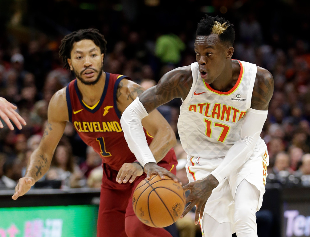 . Atlanta Hawks\' Dennis Schroder (17), from Germany, looks to pass against Cleveland Cavaliers\' Derrick Rose (1) in the first half of an NBA basketball game, Sunday, Nov. 5, 2017, in Cleveland. (AP Photo/Tony Dejak)