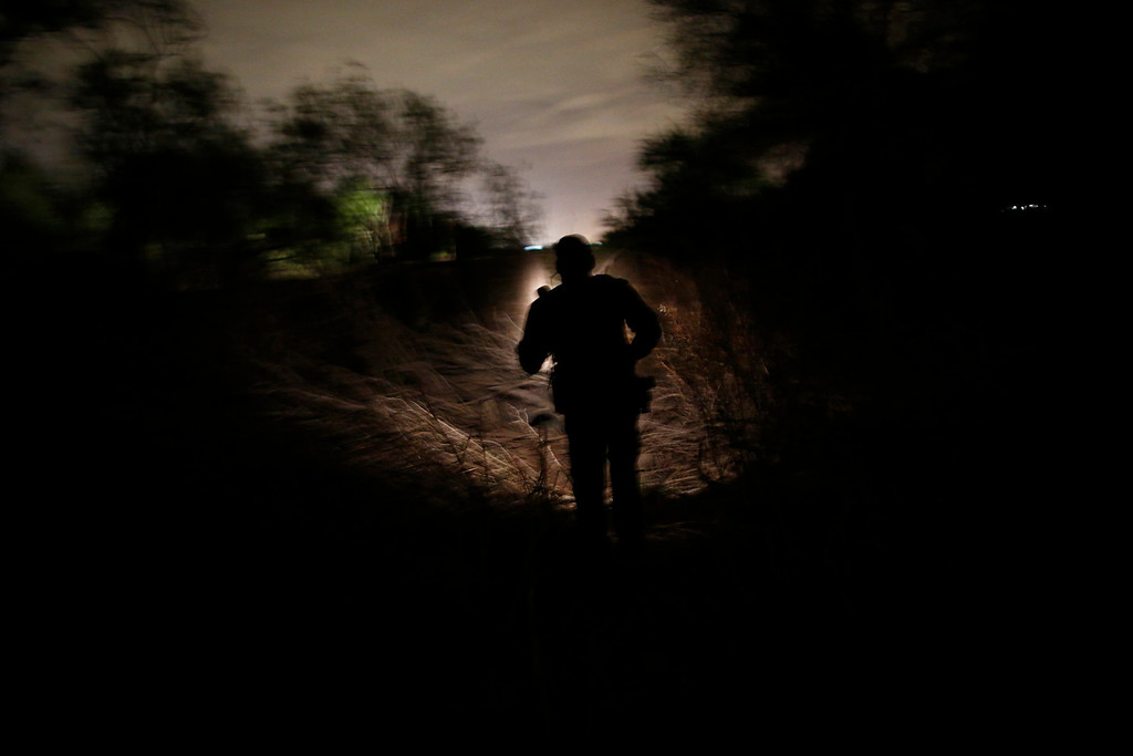 ". A U.S. Border Patrol agent from the Rio Grande Valley Sector searches for a group of illegal immigrants who crossed the Rio Grande River in Mission, Texas March 28, 2013. Brooks County has become an epicentre for illegal immigrant deaths in Texas. In 2012, sheriff\'s deputies found 129 bodies there, six times the number recorded in 2010. Most of those who died succumbed to the punishing heat and rough terrain that comprise the ranch lands of south Texas. Many migrants spend a few days in a ""stash house\"", such as the Casa del Migrante, in Reynosa, Mexico, and many are ignorant of the treacherous journey ahead. Picture taken March 28, 2013. REUTERS/Eric Thayer"