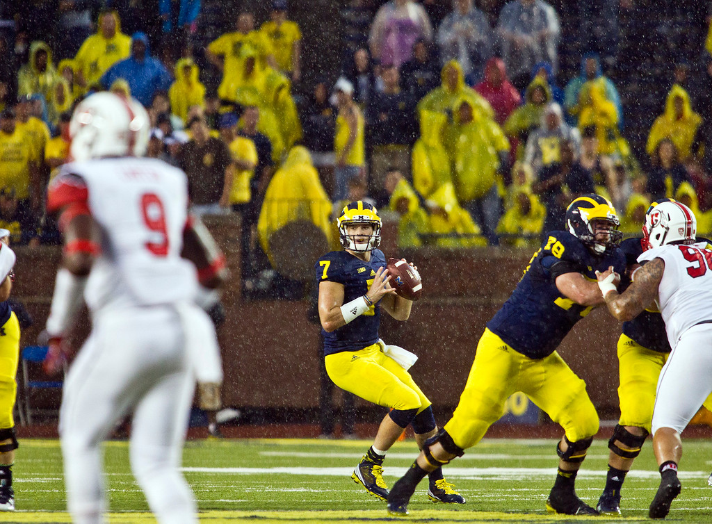. Michigan quarterback Shane Morris (7) looks to throw a pass in the fourth quarter of an NCAA college football game against Utah in Ann Arbor, Mich., Saturday, Sept. 20, 2014. Morris\' pass was intercepted by Utah defensive back Tevin Carter (9). (AP Photo/Tony Ding)