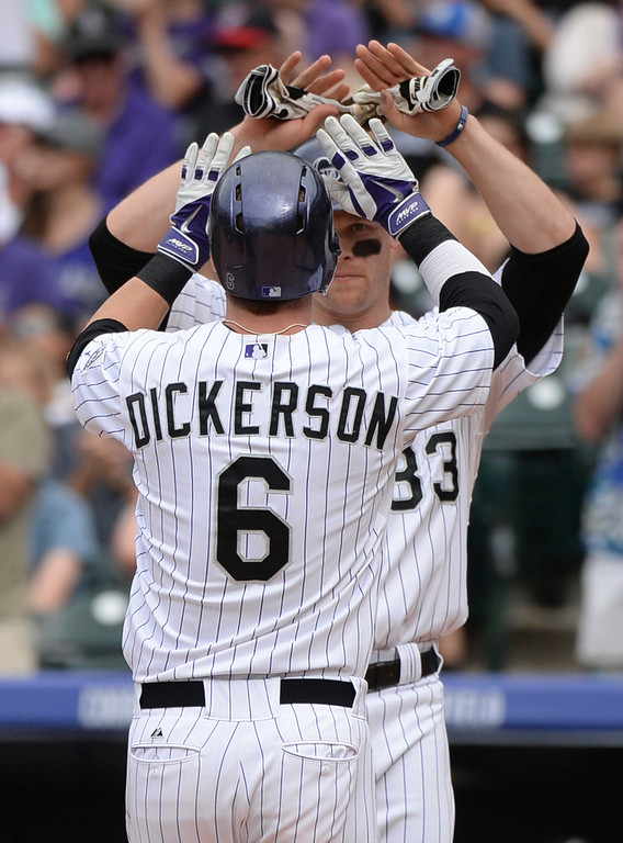 . DENVER, CO - JUNE 21: Justin Morneau met Corey Dickerson at home plate after his home run in the sixth inning. The Colorado Rockies hosted the Milwaukee Brewers at Coors Field Saturday afternoon, June 21, 2014. Photo by Karl Gehring/The Denver Post