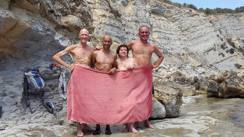 Relaxing after a hike at Playa Barraca with near nude bathing