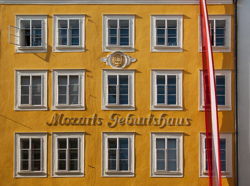 Yellow Facade of Mozart's Birthplace on Getreidegasse Street in Salzburg, Austria