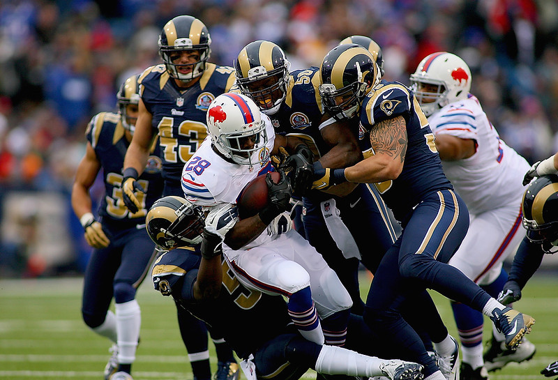 . C.J. Spiller #28 of the Buffalo Bills is tackled by the St. Louis Rams at Ralph Wilson Stadium on December 9, 2012 in Orchard Park, New York. (Photo by Rick Stewart/Getty Images)