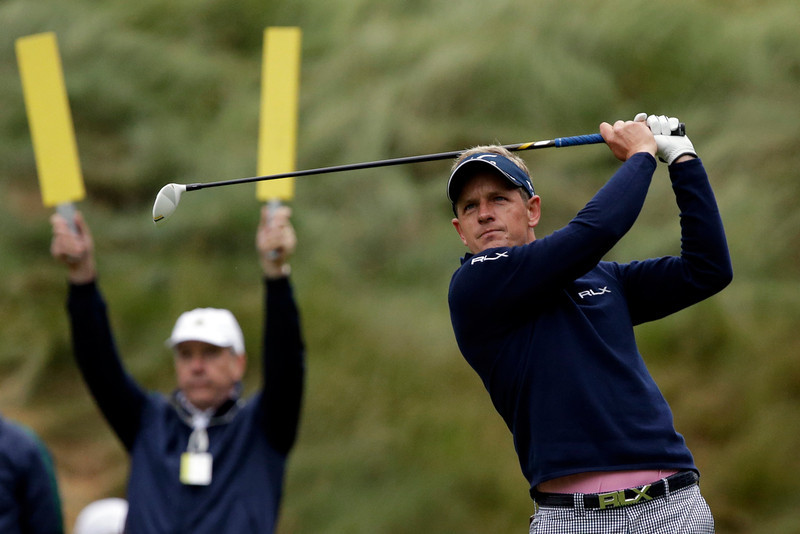 . Luke Donald, of England, tees off on the 18th hole during the first round of the U.S. Open golf tournament at Merion Golf Club, Friday, June 14, 2013, in Ardmore, Pa. (AP Photo/Gene J. Puskar)