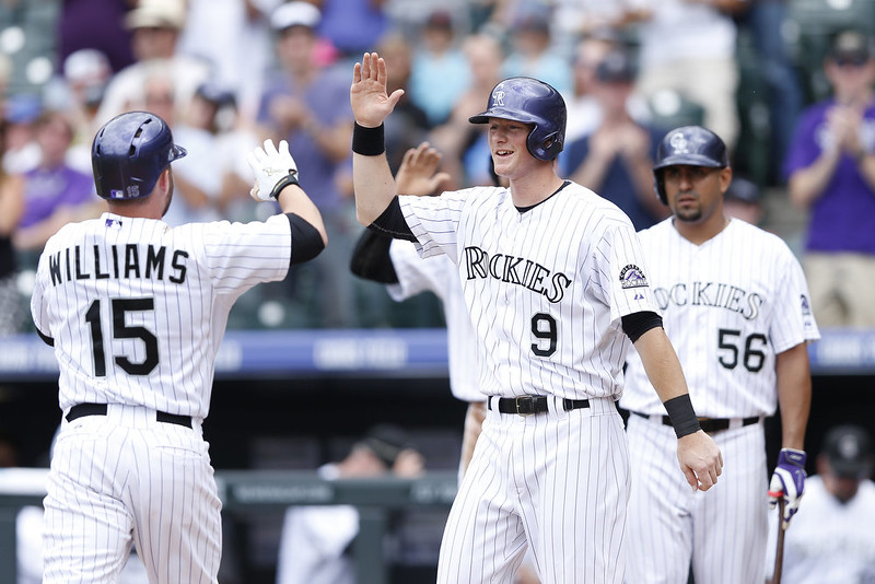 . Jackson Williams #15 of the Colorado Rockies is congratulated by DJ LeMahieu #9 after hitting a three-run home run in the second inning of the game against the San Diego Padres at Coors Field on September 7, 2014 in Denver, Colorado. (Photo by Joe Robbins/Getty Images)
