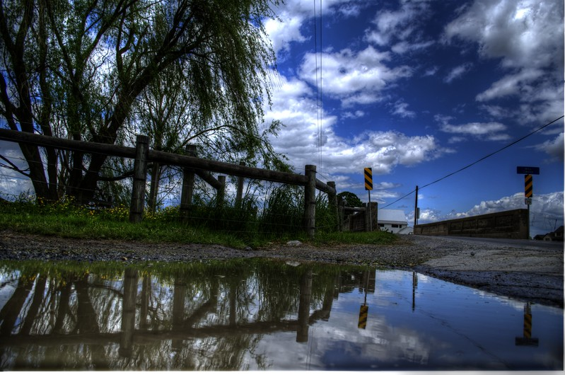 puddle - backroad, bridge, clouds.jpg