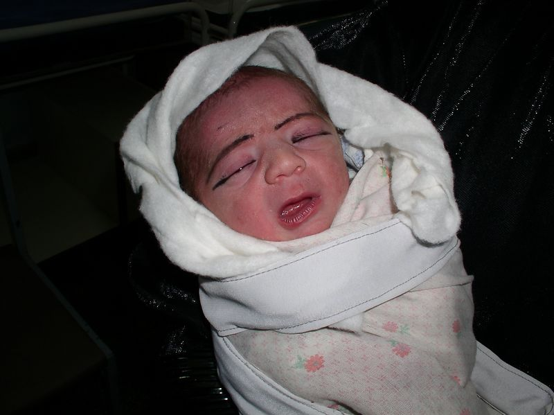 Preemie going home - complete with eyebrows/eyeliner. One of our successful resuscitations.